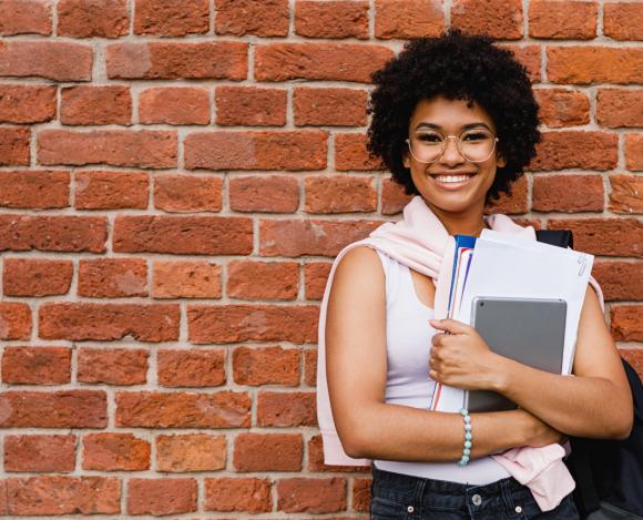 african american woman holding school books choosing a career path