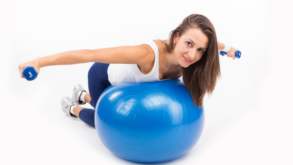 woman doing reverse fly on yago ball, fitness and working out
