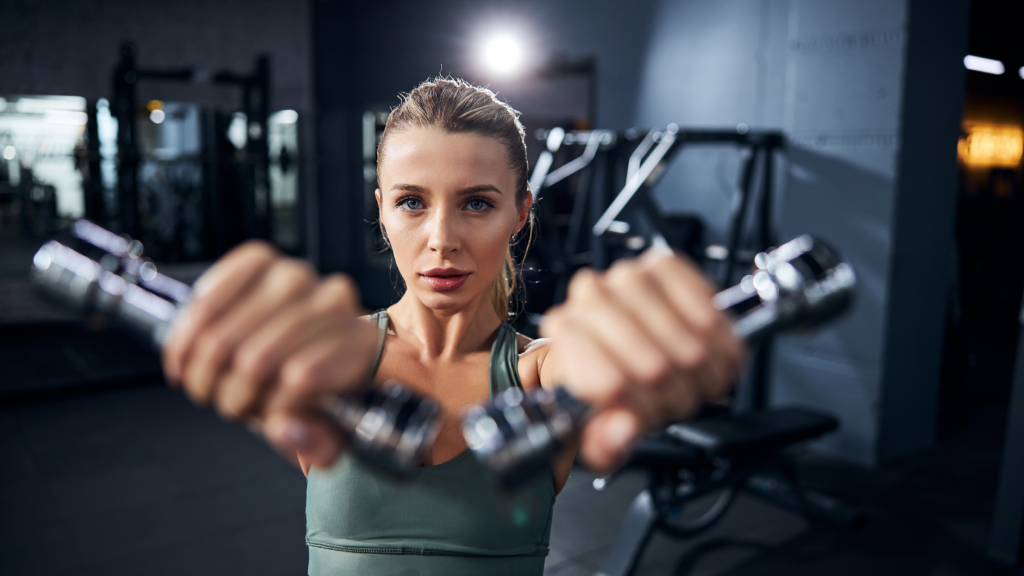 woman working out, front raise