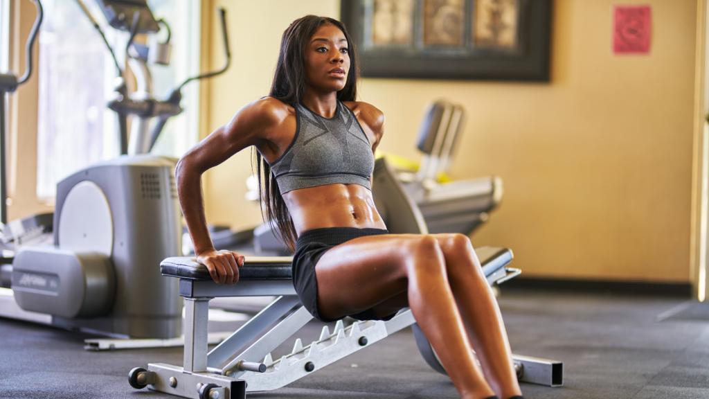 fitness model doing tricep dips