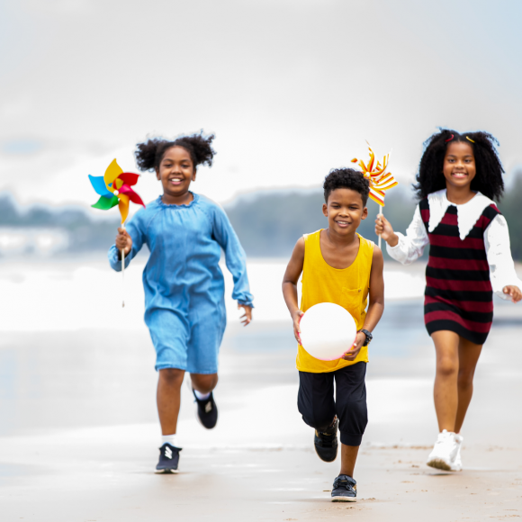 traveling abroad with kids running on a beach